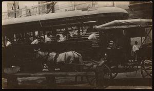 "Tramway and horse-drawn carriage. Santa Ana Square, Panama City. Sign on top of tram windows reads: ""Panama Tramways Company."" (Note that this particular park bench design was only found at Santa Ana Square.) Photograph verso text: ""Spick Cabs (ride over all over for a dime) (ponies)""   Tranvía y carruaje tirado por caballo. Plaza de Santa Ana, ciudad de Panamá. Letrero sobre las ventanas del tranvía lee: ""Panama Tramways Company."" (Nótese que el diseño particular de la banca solo se encuentra en la Plaza de Santa Ana.) Texto en el verso de la fotografía: ""Taxi hispano [despectivo] (pasié todas por todas partes por 10 centavos) (jacas)"""